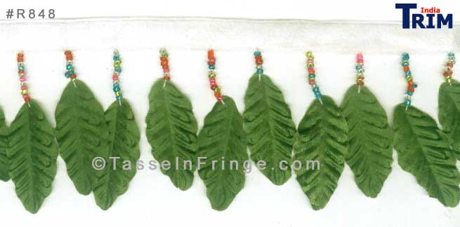 Multicolored seed beads with a rich green silky fabric leaf