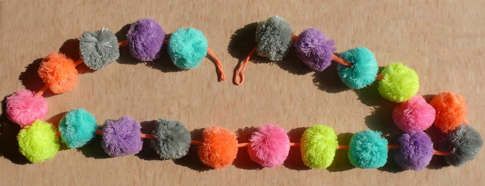 Multi Color Pom Pom Garland made by hand in wool, are for decorating and hanging